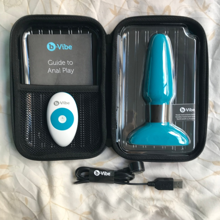 B-Vibe Rimming Plug 2 with black case opened revealing charger and anal guide