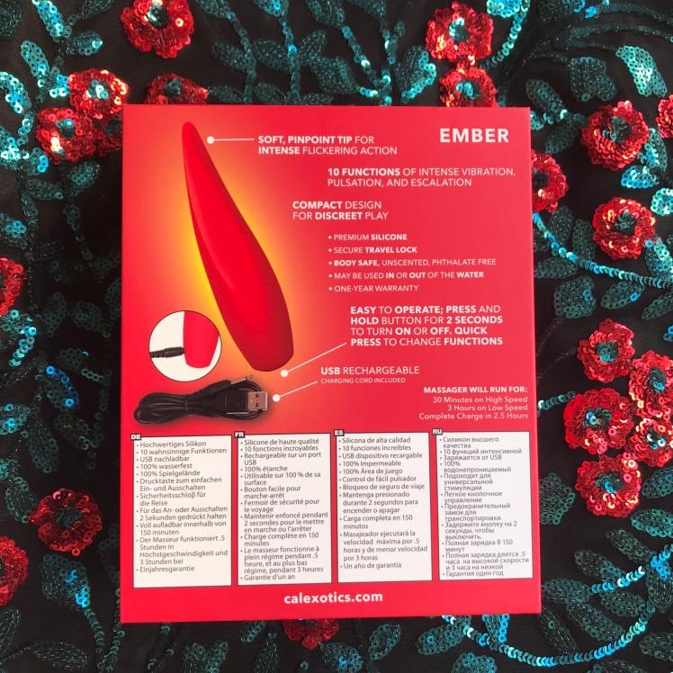 Backside of Red Hot Ember packaging against sequin floral backdrop.
