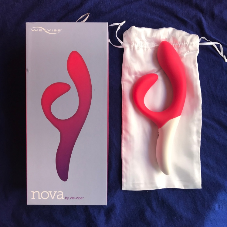 We-Vibe packaging resting side-by-side to We-Vibe Nova and dustbag