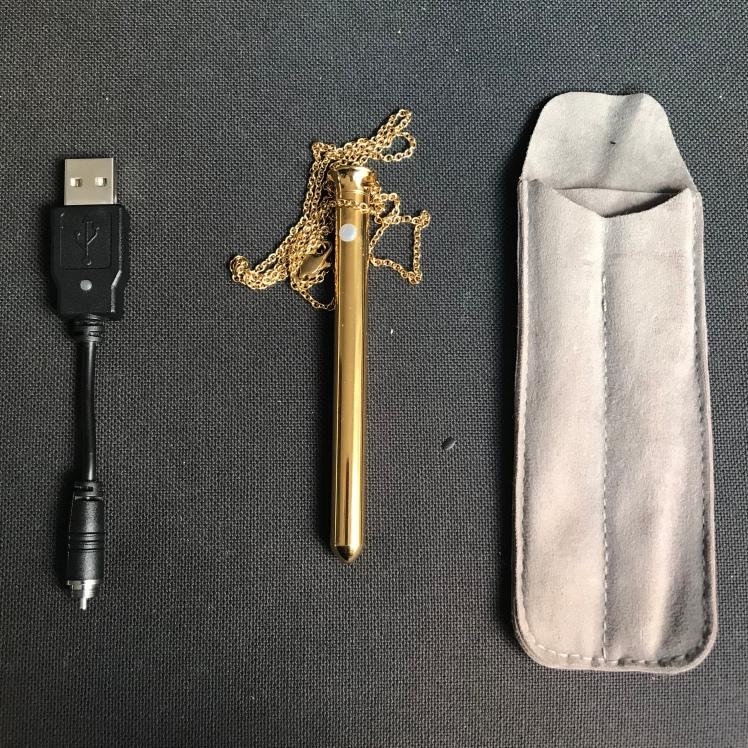 Vesper Crave centered beside dust bag and charger