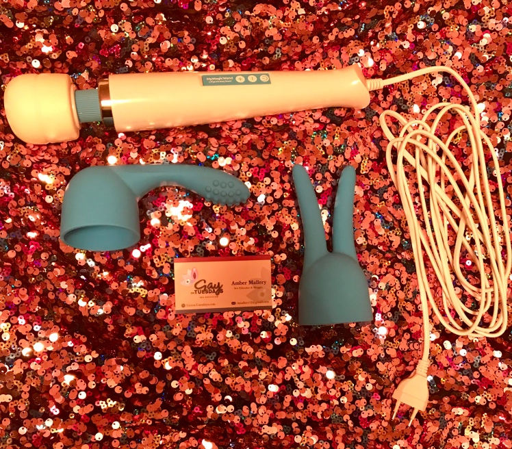 MyMagicWand beside attachments on a sequin backsplash