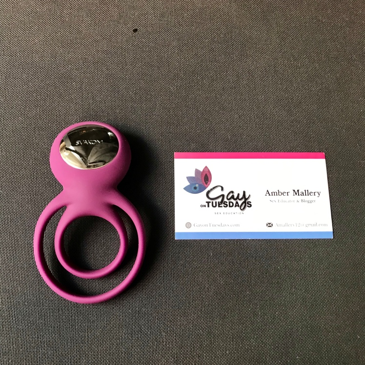 Back shot of Tammy Double Ring Couple's Vibrator beside a Gay on Tuesdays business card