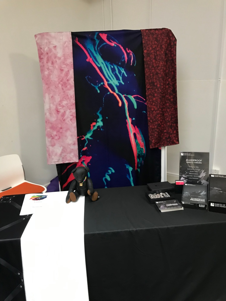 Three different styles of product by sheets of SF. A pink feathered pattern, a neon body glow, and a solid black