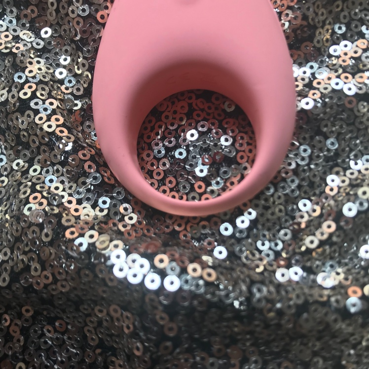 Lovely 2.0 in pink, set on top of a gold sequin background. A close up look of Lovely 2.0 band size