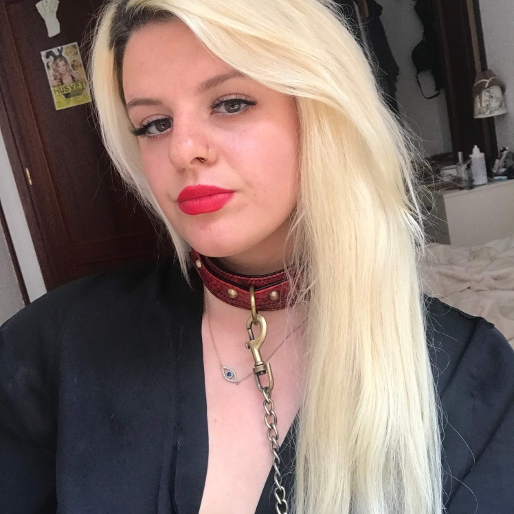Myself wearing Bondage Boutique Faux Snakeskin Collar and Leash while wearing a silky black robe and red lipstick.