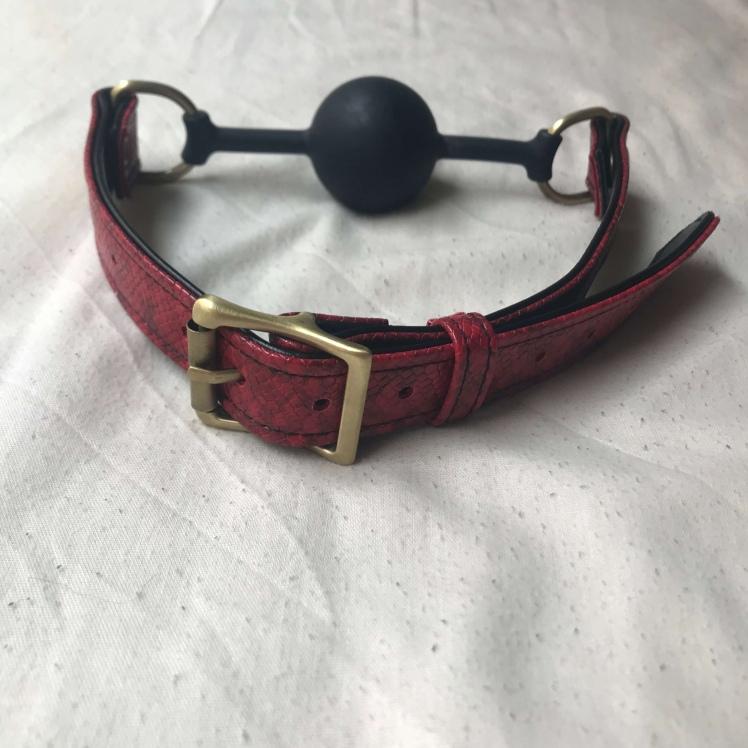 Backside close up of Bondage Boutique Faux Snakeskin Silicone Ball Gag